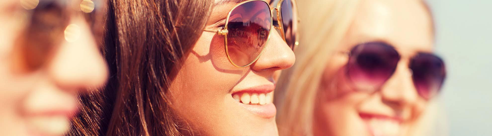 Group of women wearing sunglasses